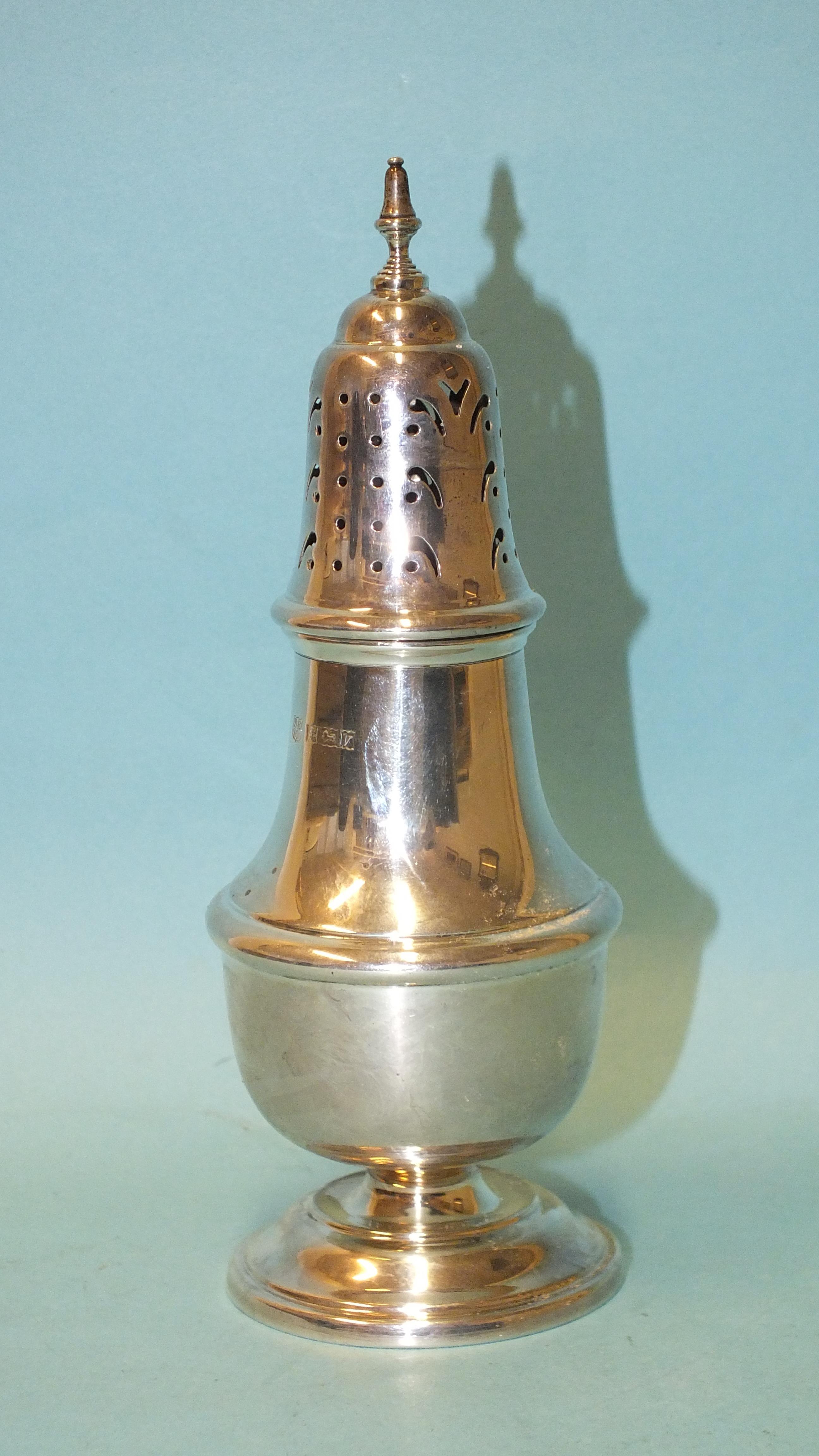 A modern silver sugar caster of baluster form, makers BES Co, Birmingham 1970, 17.5cm, ___2oz.