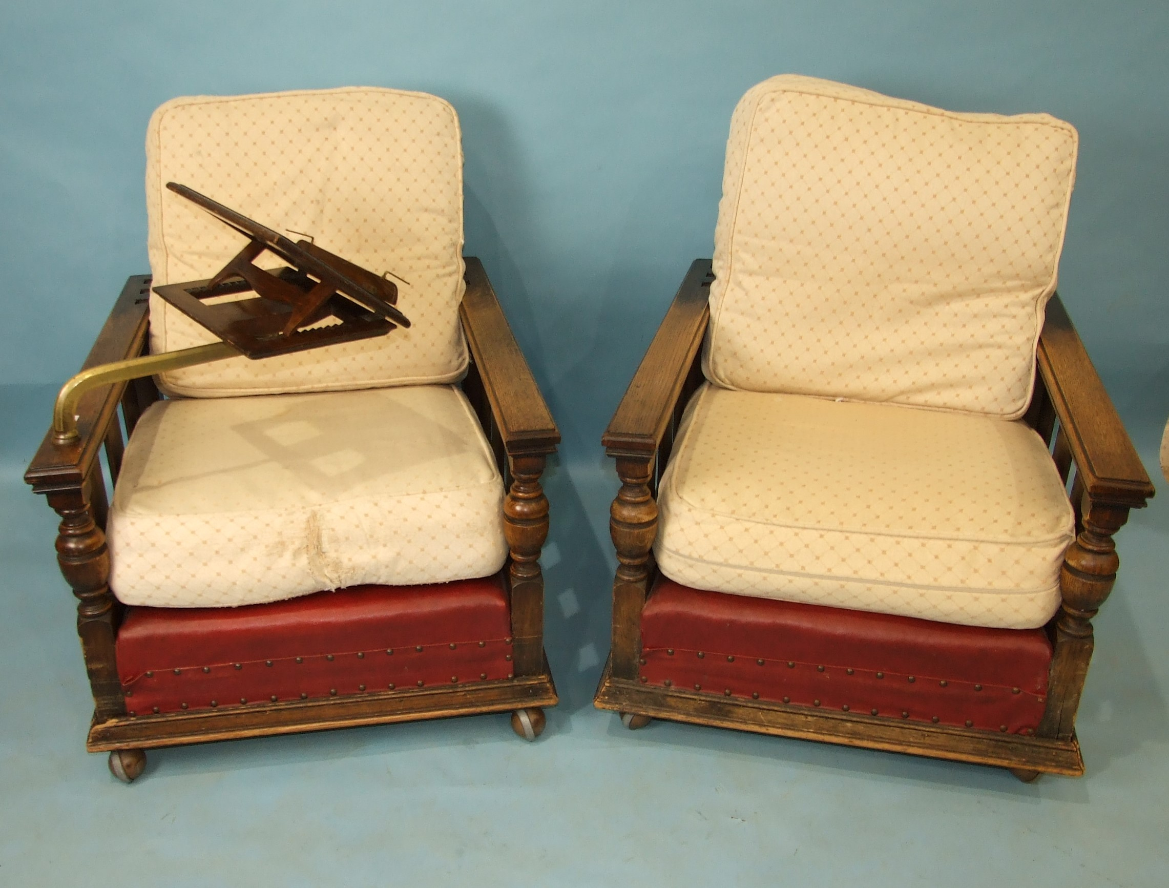 A pair of 1930's oak deep-seated armchairs with adjustable backs, on later castors, one with - Image 2 of 3