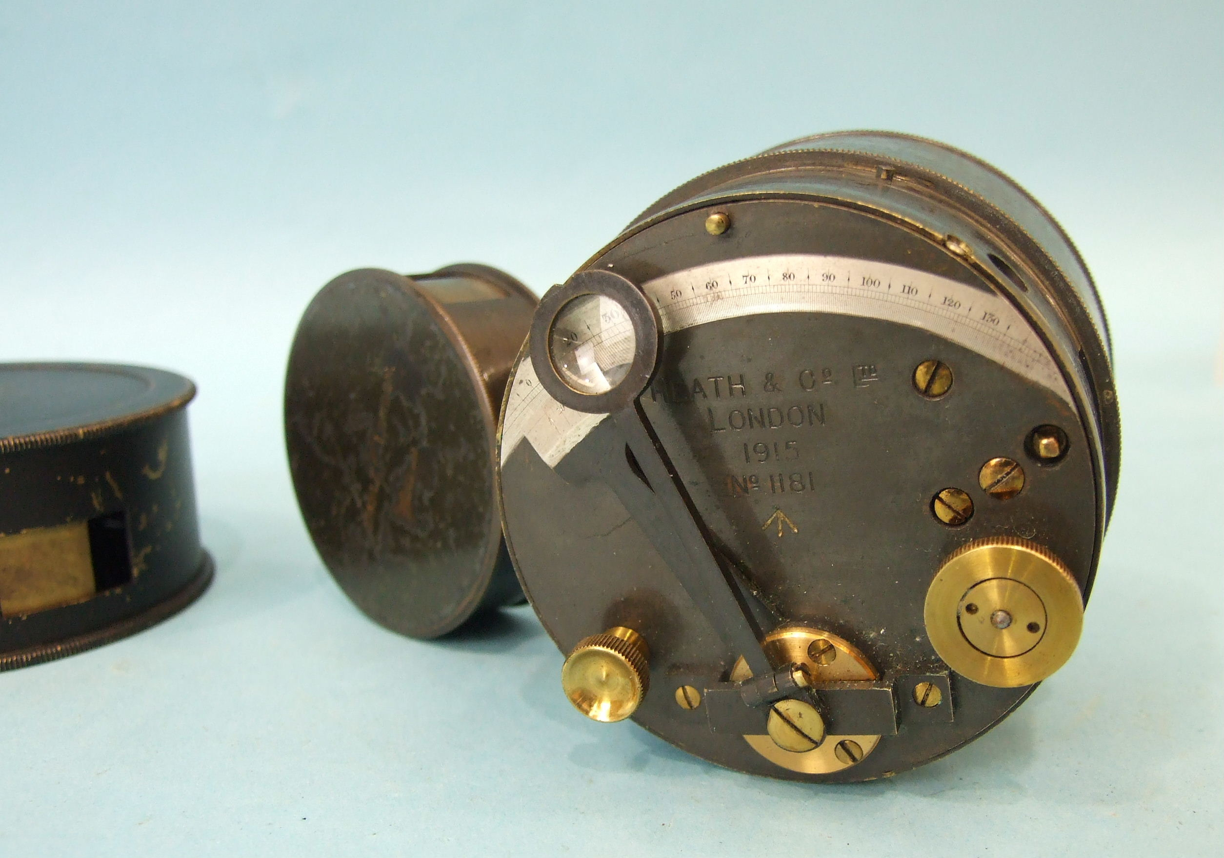 A Heath & Co. Ltd pocket drum sextant dated 1915, no.1181 and two pocket levels, one marked MDS Ltd,