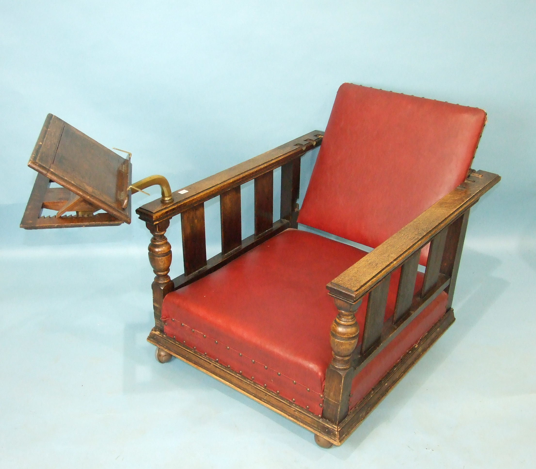A pair of 1930's oak deep-seated armchairs with adjustable backs, on later castors, one with - Image 3 of 3
