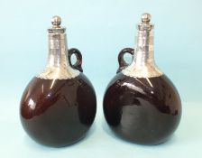 A pair of Victorian amber glass silver-mounted brandy and whisky flasks and stoppers by Hawksworth