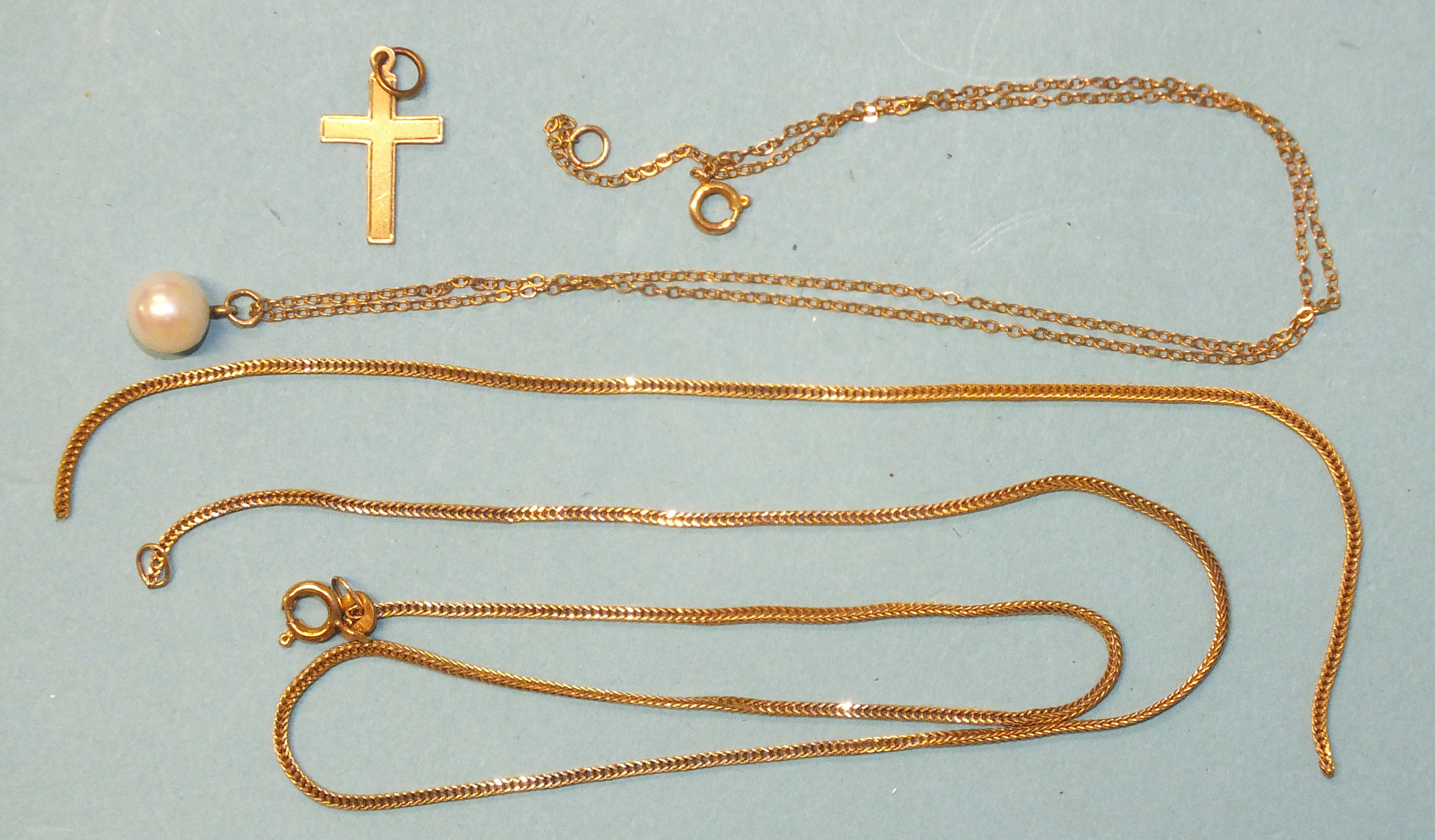 A pearl pendant, (beads 8mm approximately), on 40cm 9ct gold chain, a 9ct gold cross pendant and a