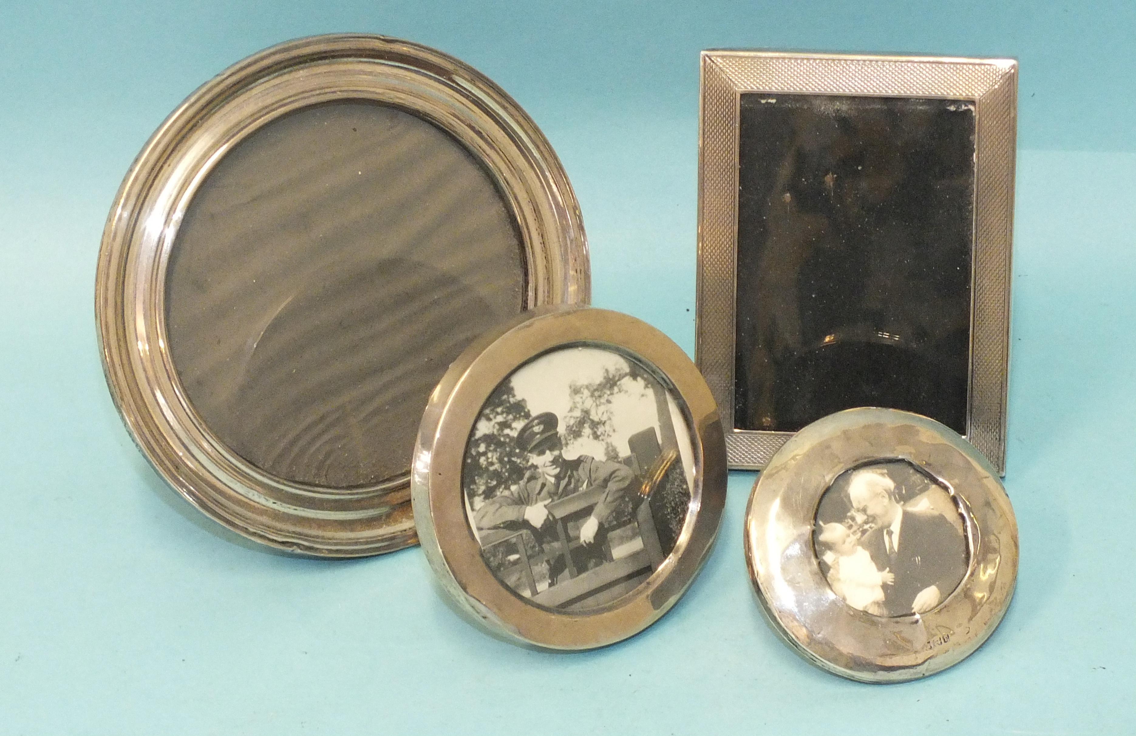 A small engine-turned silver photograph frame, 7.3 x 9.8cm, Birmingham 1950 and three circular