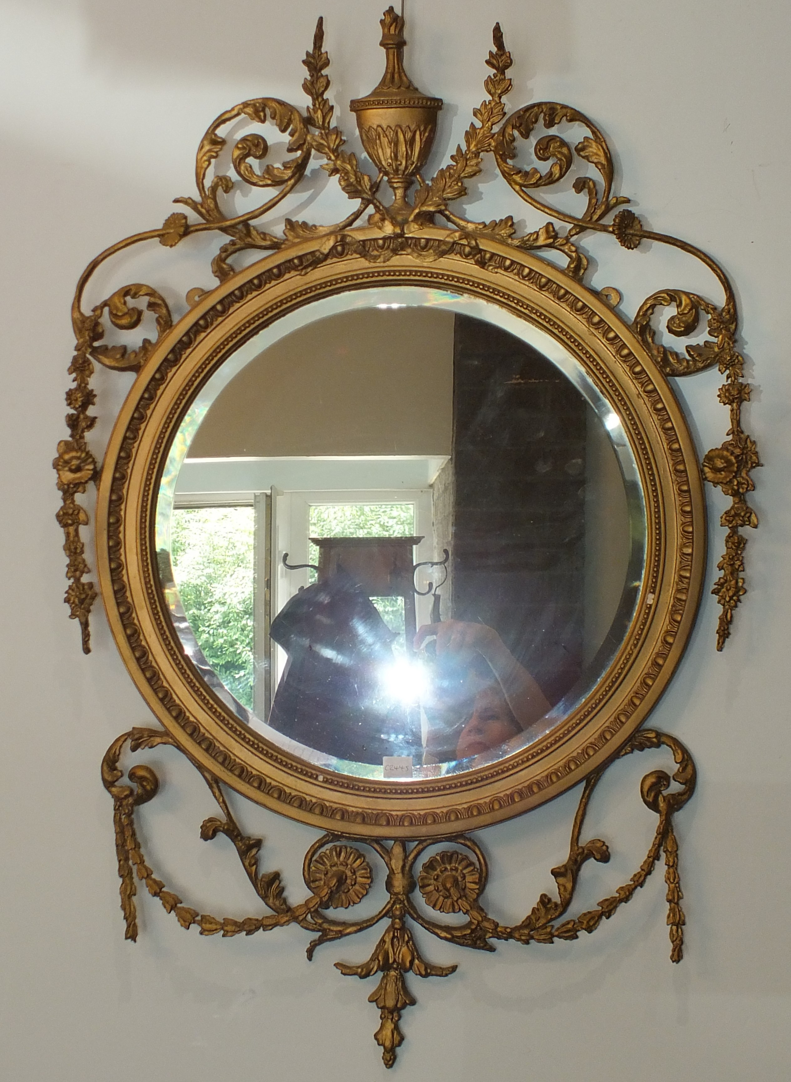 A pair of Victorian Adams-style circular gilt gesso wall mirrors, each bevelled plate with beaded