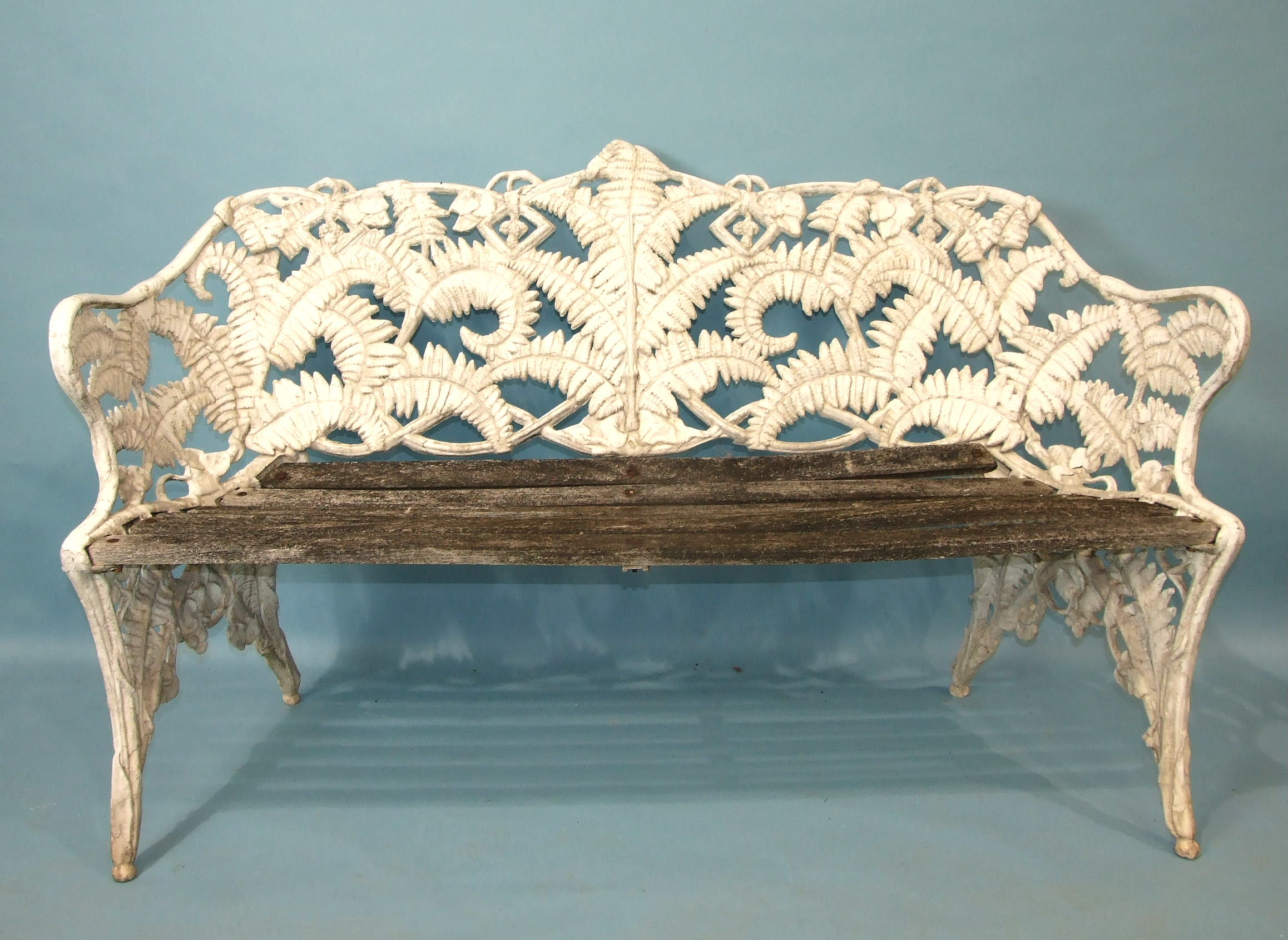 A cast alloy Coalbrookedale-style fern pattern garden bench, (the wooden slatted seat in need of