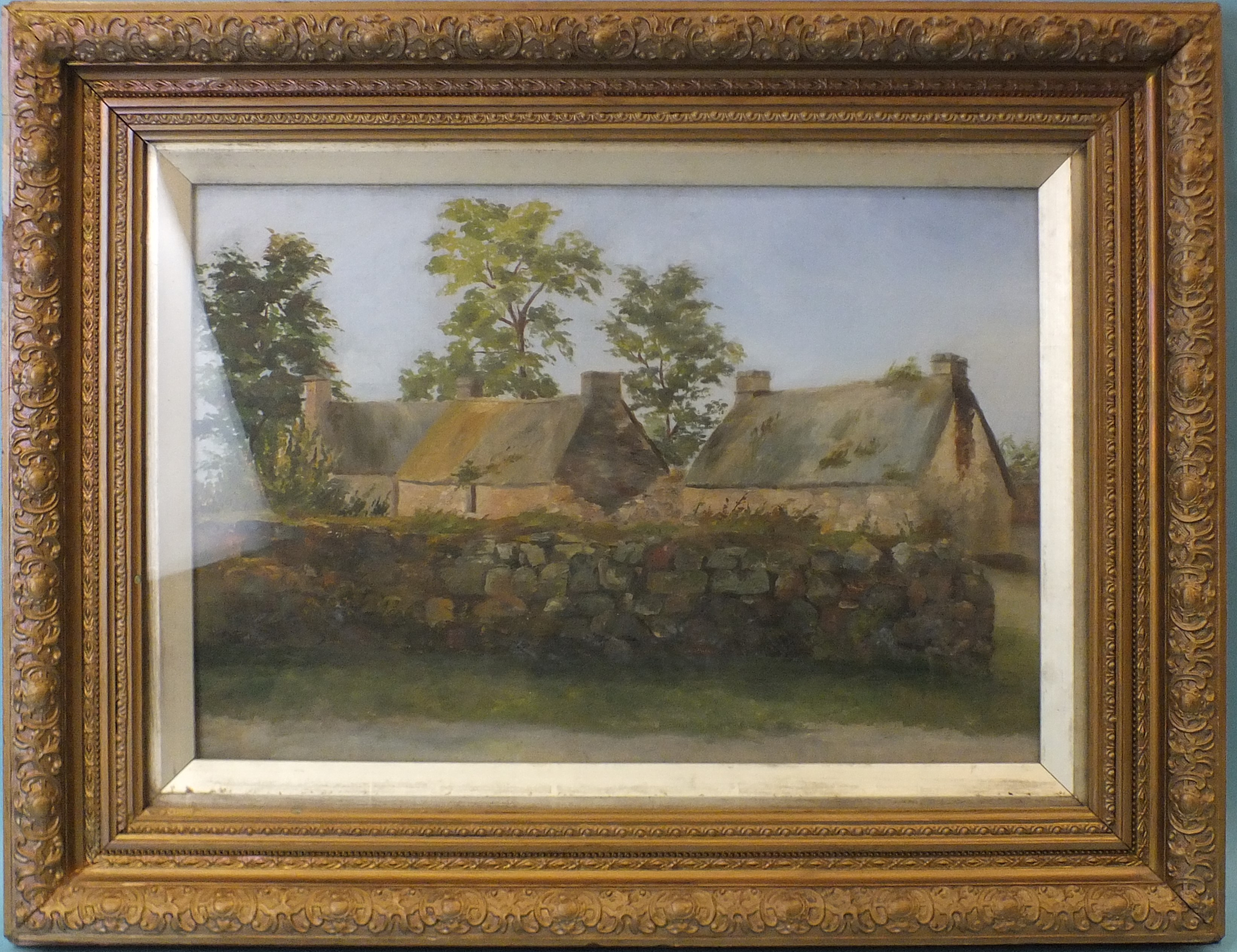 Late-19th/early-20th century GROUP OF THREE THATCHED COTTAGES BEHIND A STONE WALL Unsigned oil on