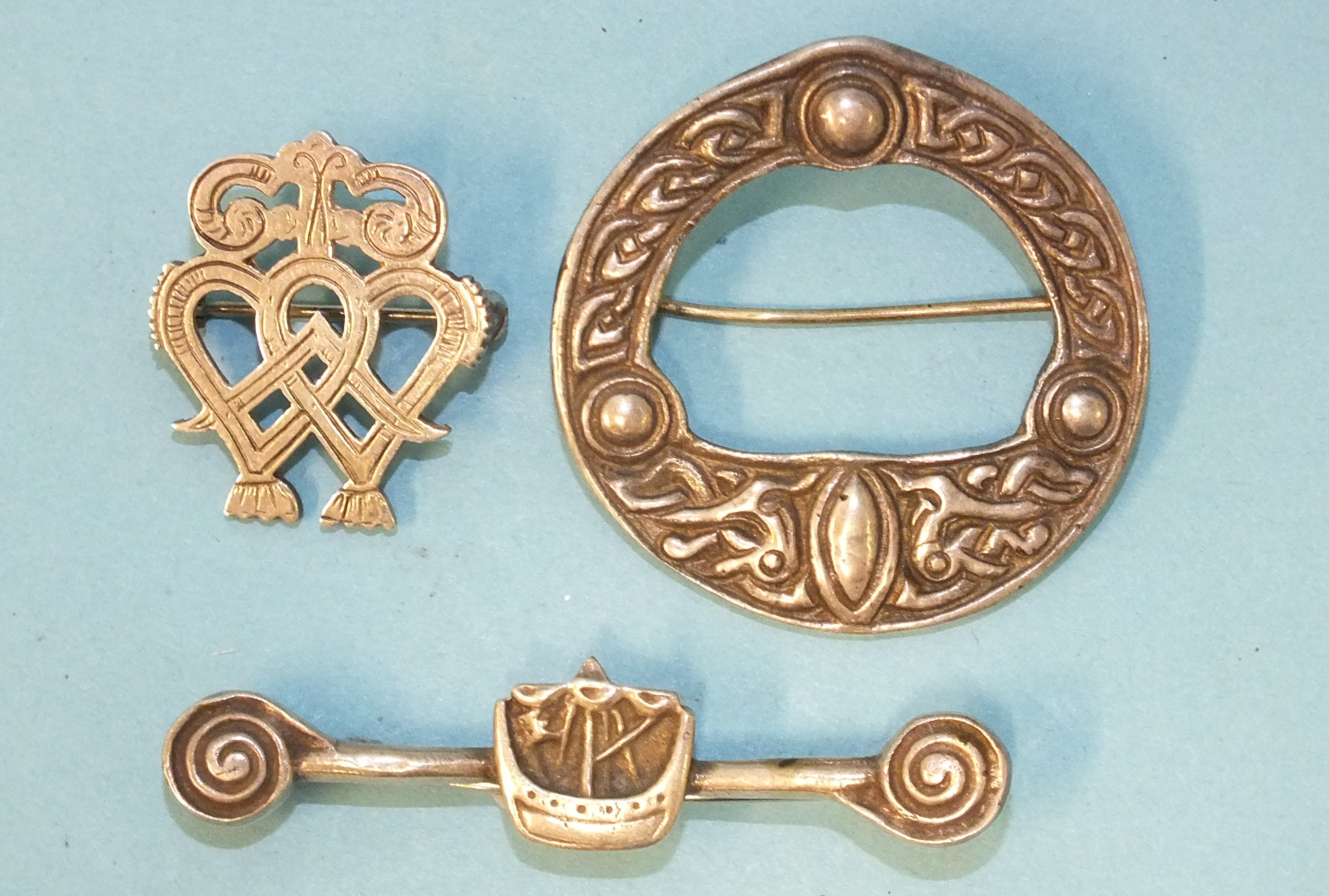 An Ola Gorie of Orkney silver luckenbooth brooch/pendant, 25mm high, a Robert Allison of Iona Celtic