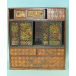A walnut and parquetry Oriental jewellery cabinet, the rectangular top above two slides, a drawer,