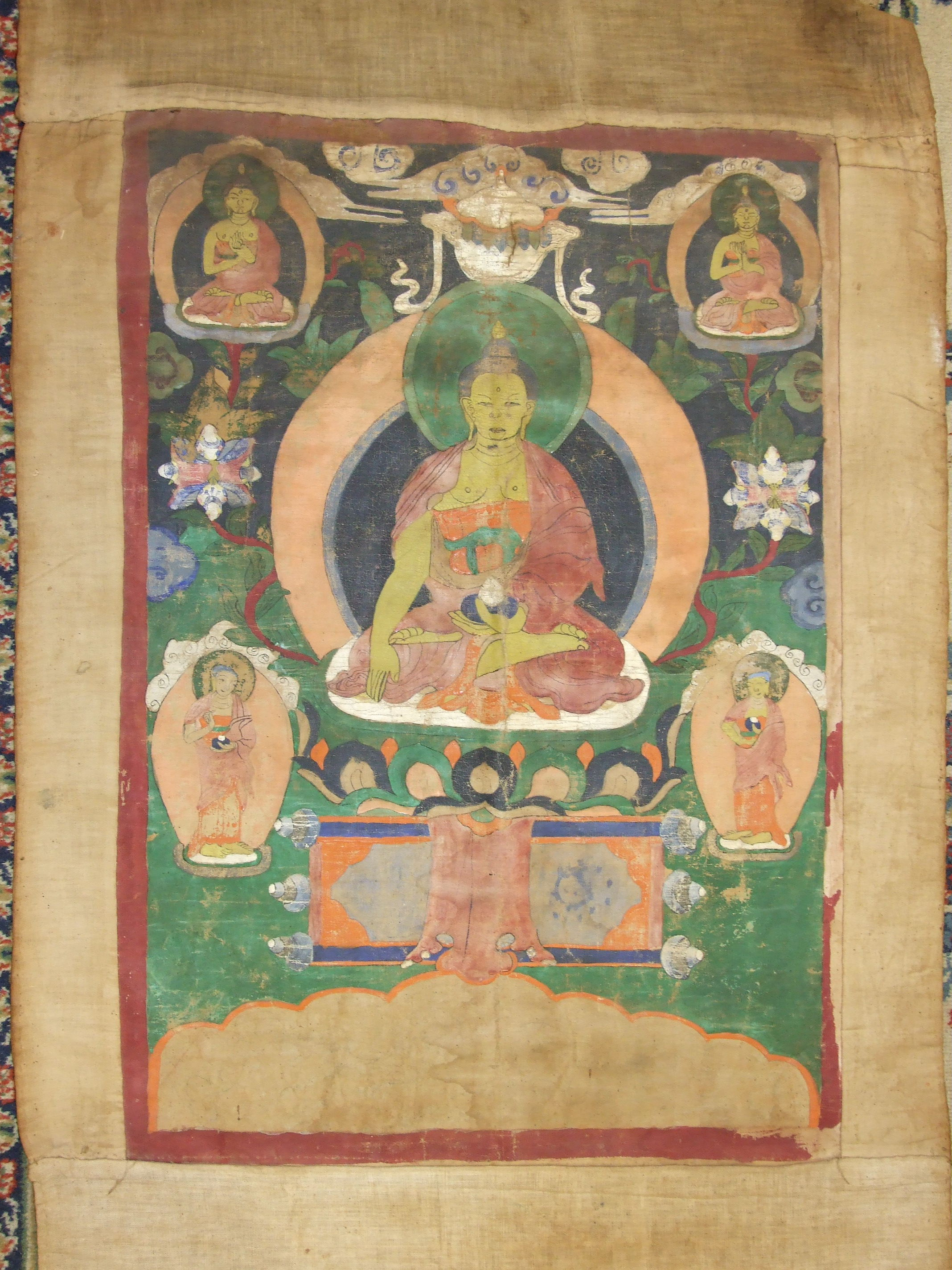 An early-20th century Tibetan painted cloth scroll depicting deities within a tree of life design, - Image 2 of 2
