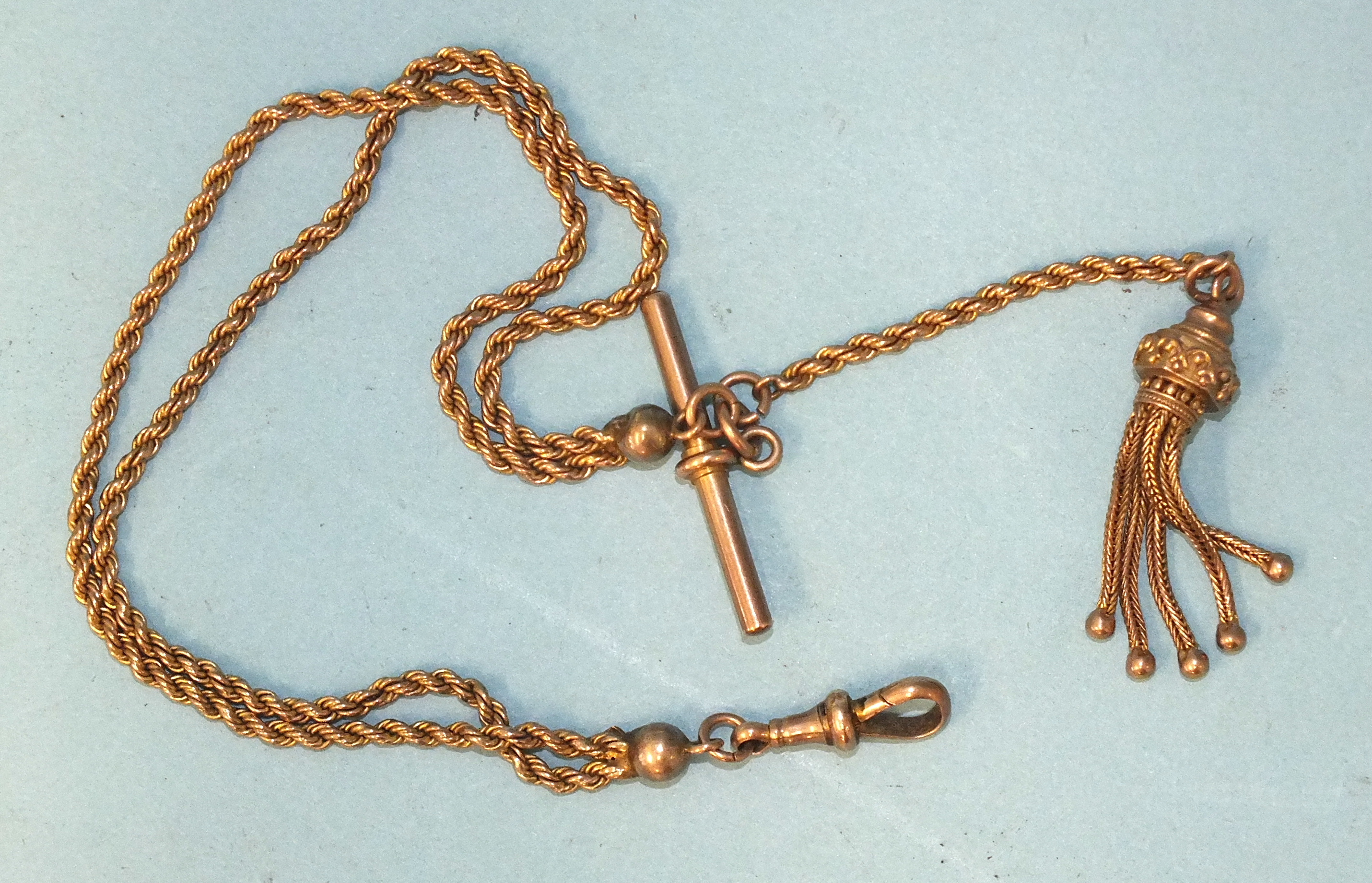 A Victorian 9ct gold half-Albert watch chain of two rope-twist chains, with tassel, T-bar and