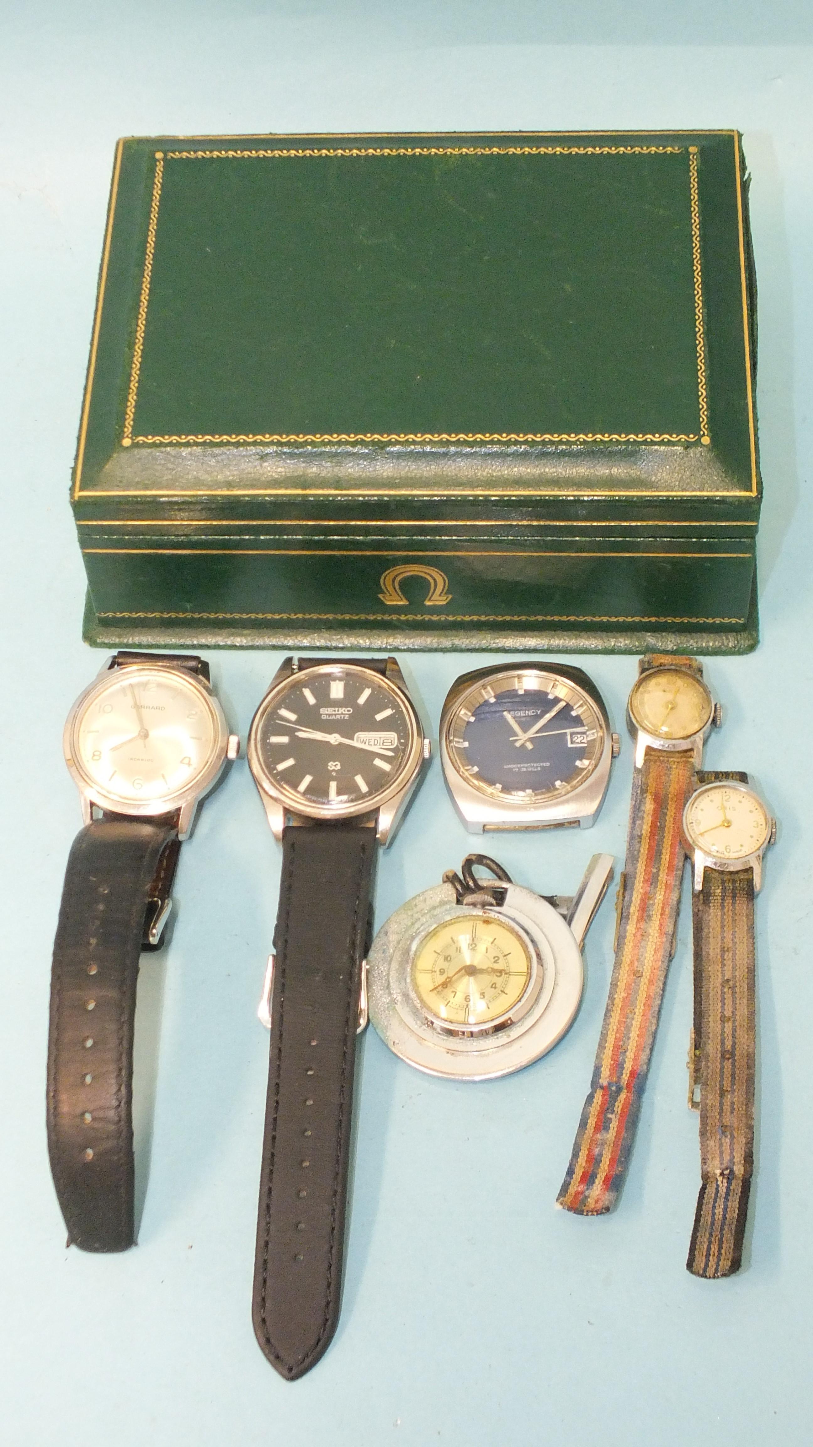 Garrard, a gentleman's Garrard Incabloc steel-cased wrist watch and other watches, in an Omega