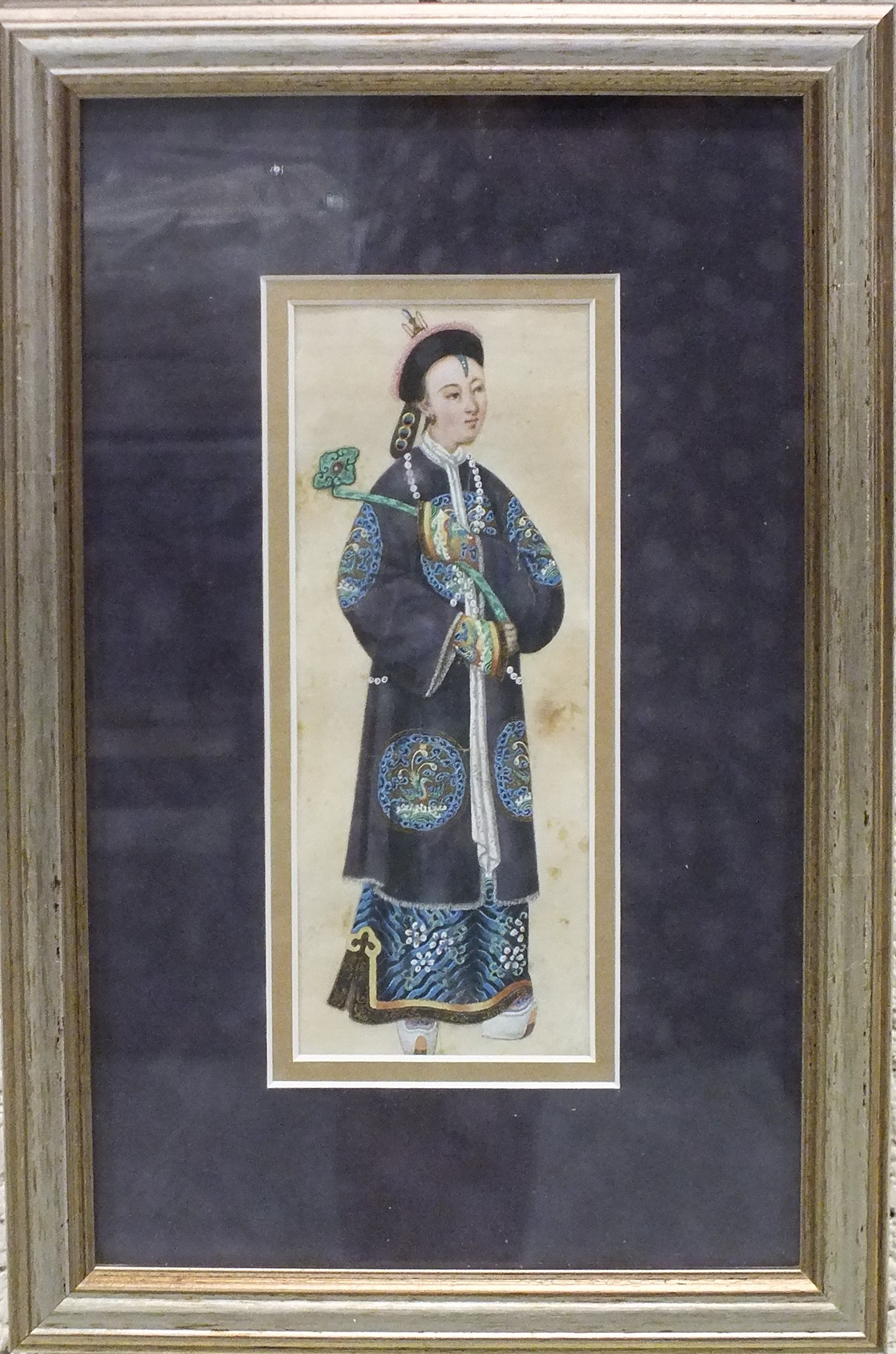 A late-19th century rice paper watercolour depicting a young man in traditional costume, wearing