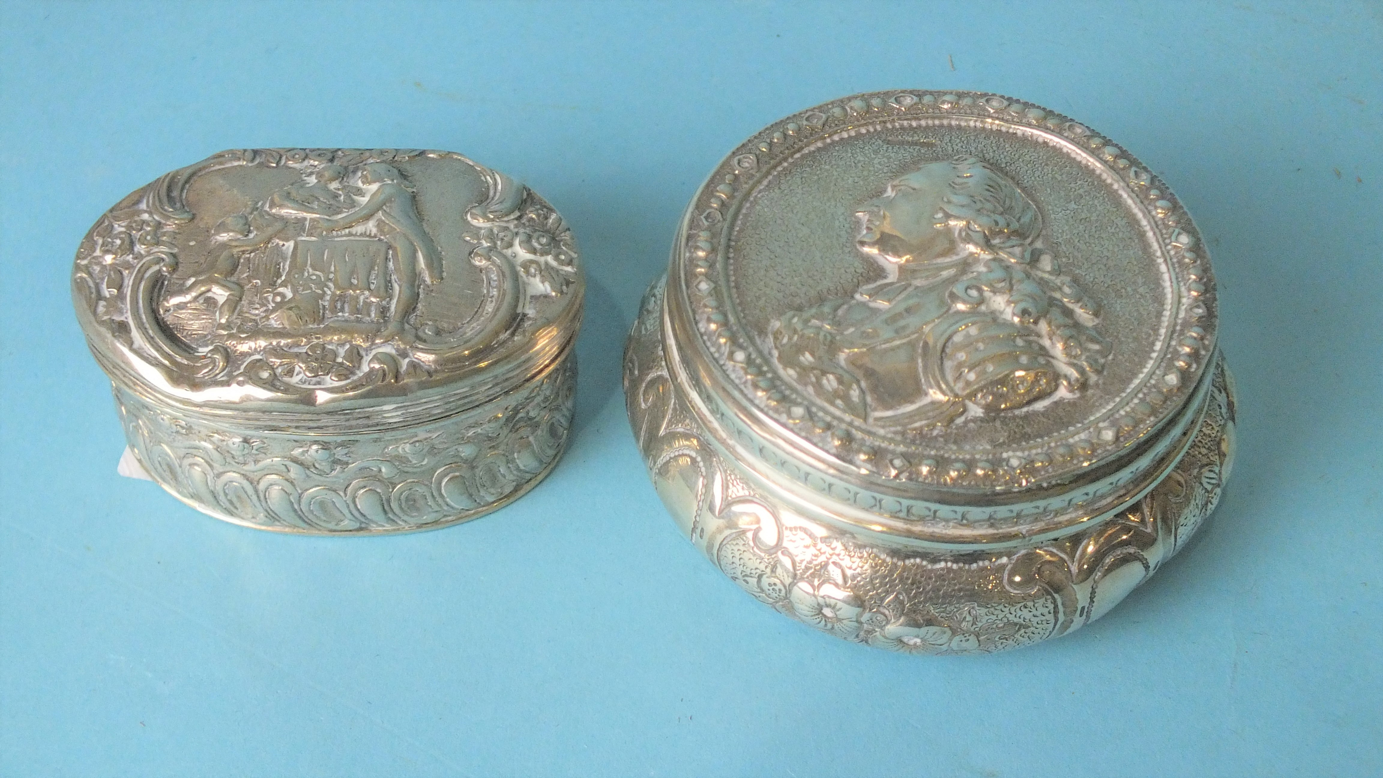 A French circular box and cover, the lid embossed with bust of a nobleman, 7cm diameter, with import