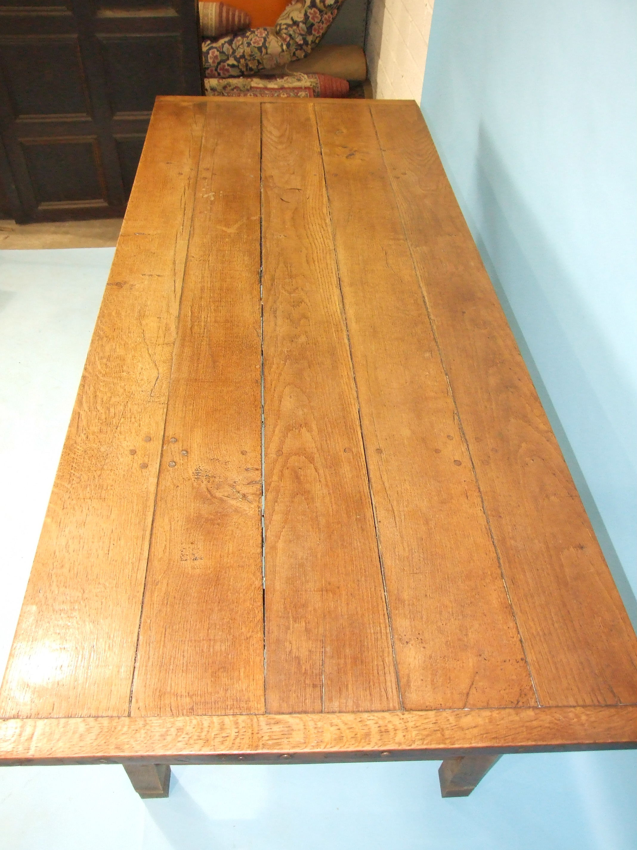 A reconstructed oak farmhouse-style table, the planked top on square tapered legs joined by - Image 2 of 3