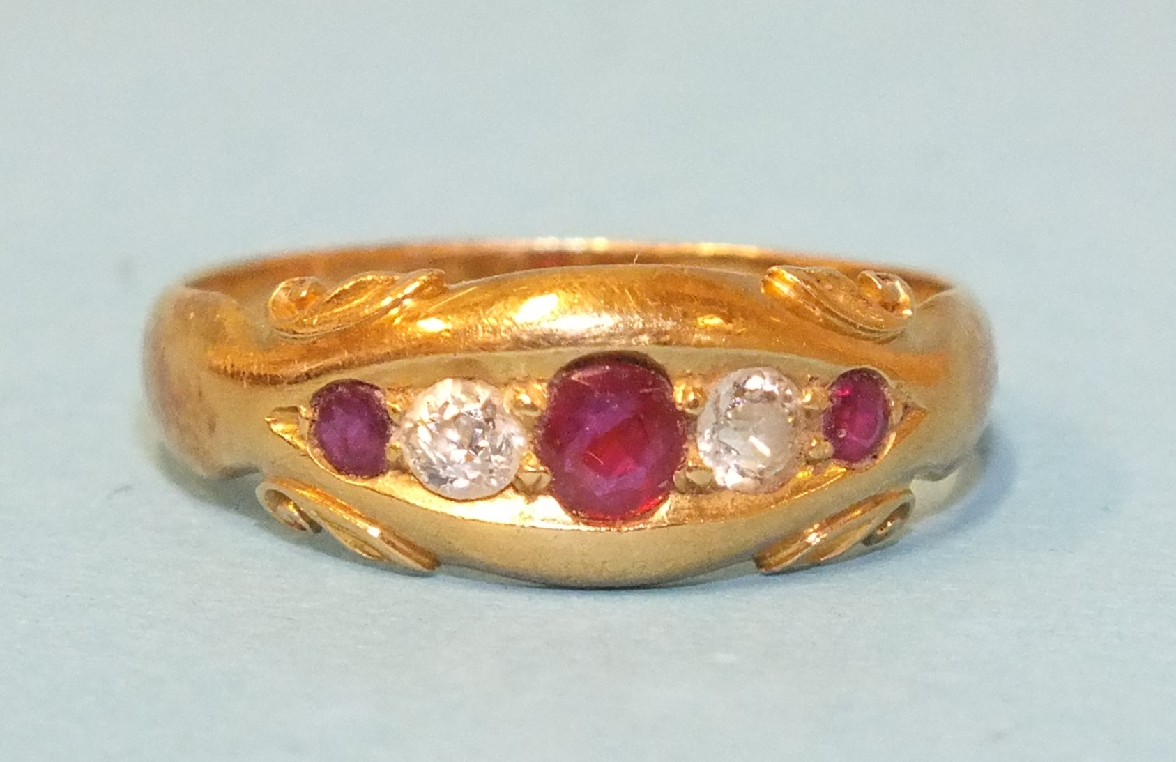 A Victorian gipsy ring set two brilliant-cut diamonds and three round-cut rubies, in 18ct rose