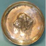 A small shallow dish embossed with the profile of a bloodhound, maker S & Co, Birmingham 1910,