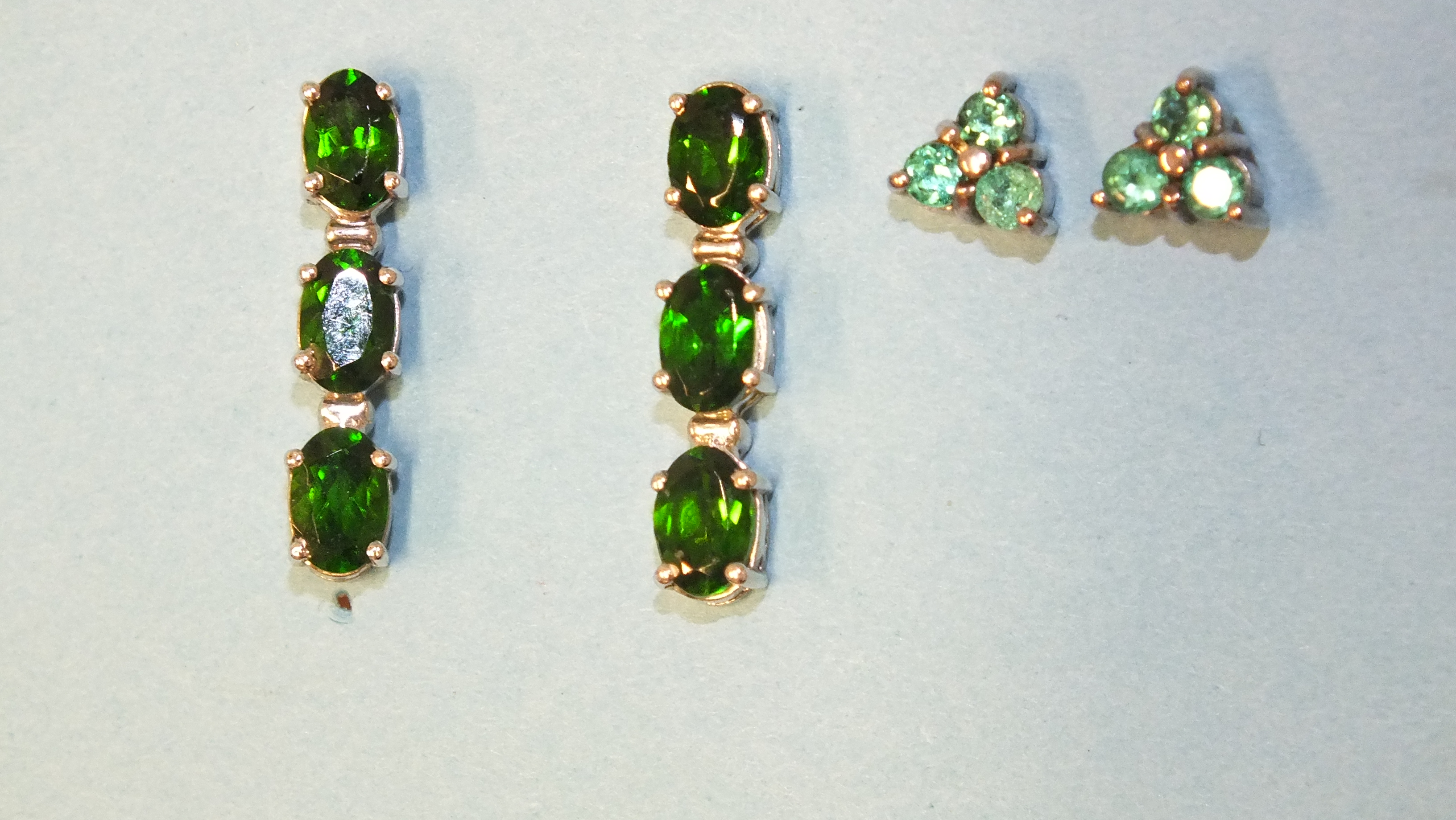 A pair of silver earrings, each set a line of three chrome diopsides and a pair of silver ear studs, - Image 2 of 2