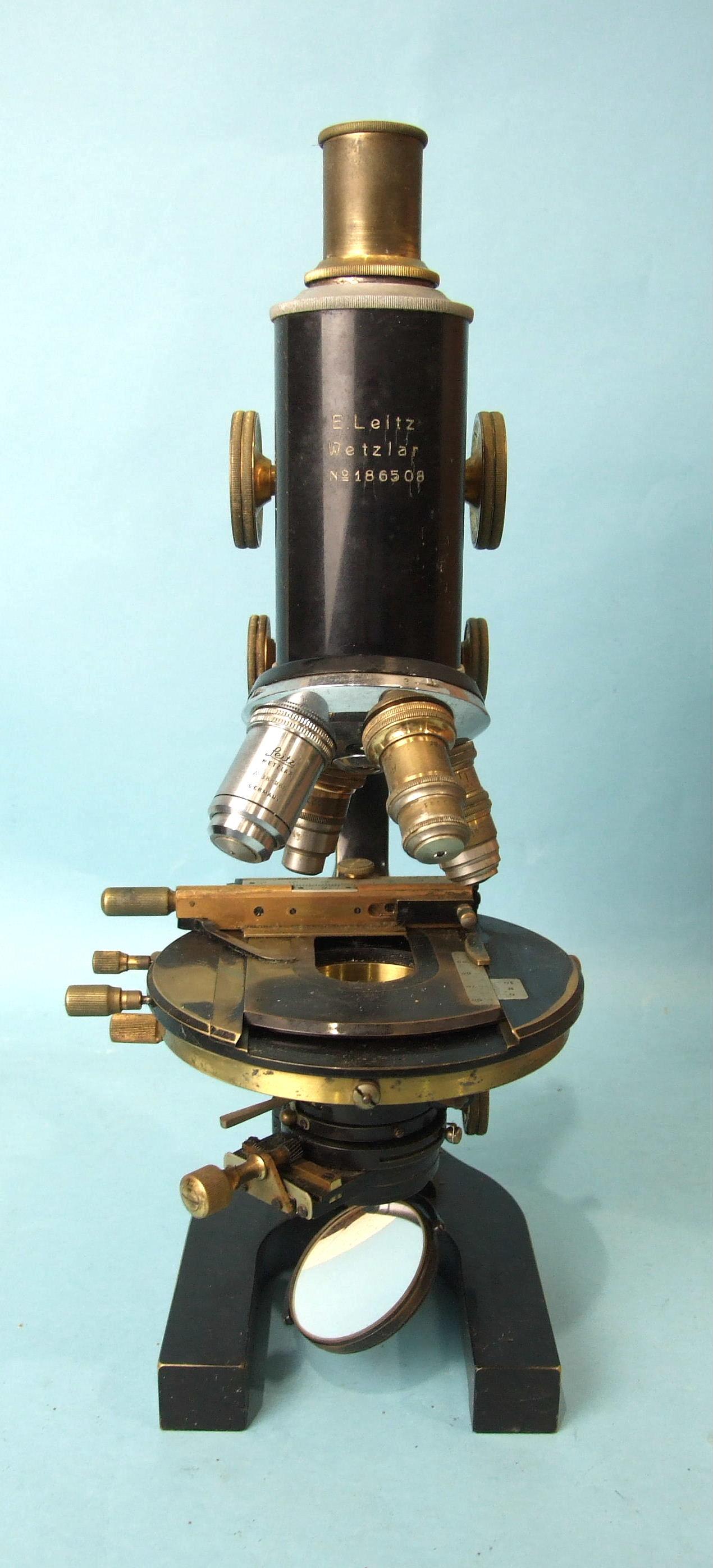 An E Leitz Wetzlar lacquered bronze monocular microscope no.186508, with accessories, in original