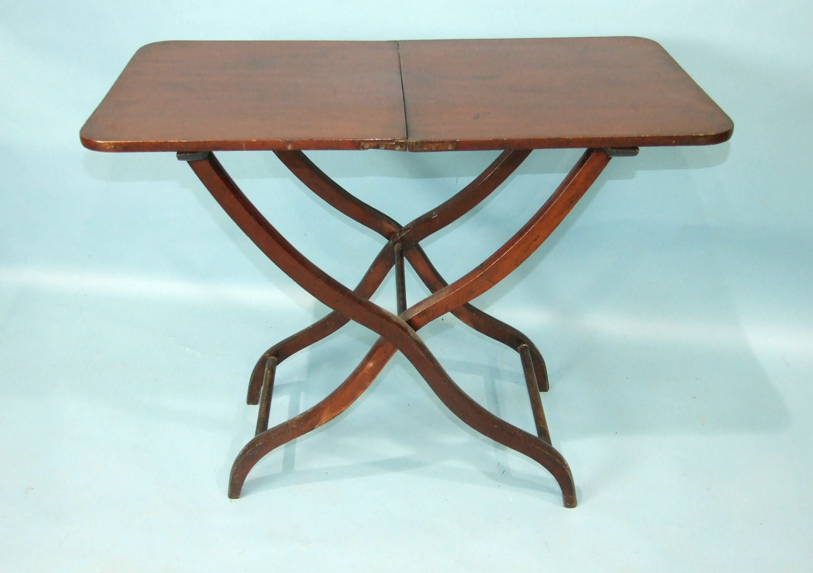 A 19th century mahogany hunting table, the rectangular folding top with flush hinges, on