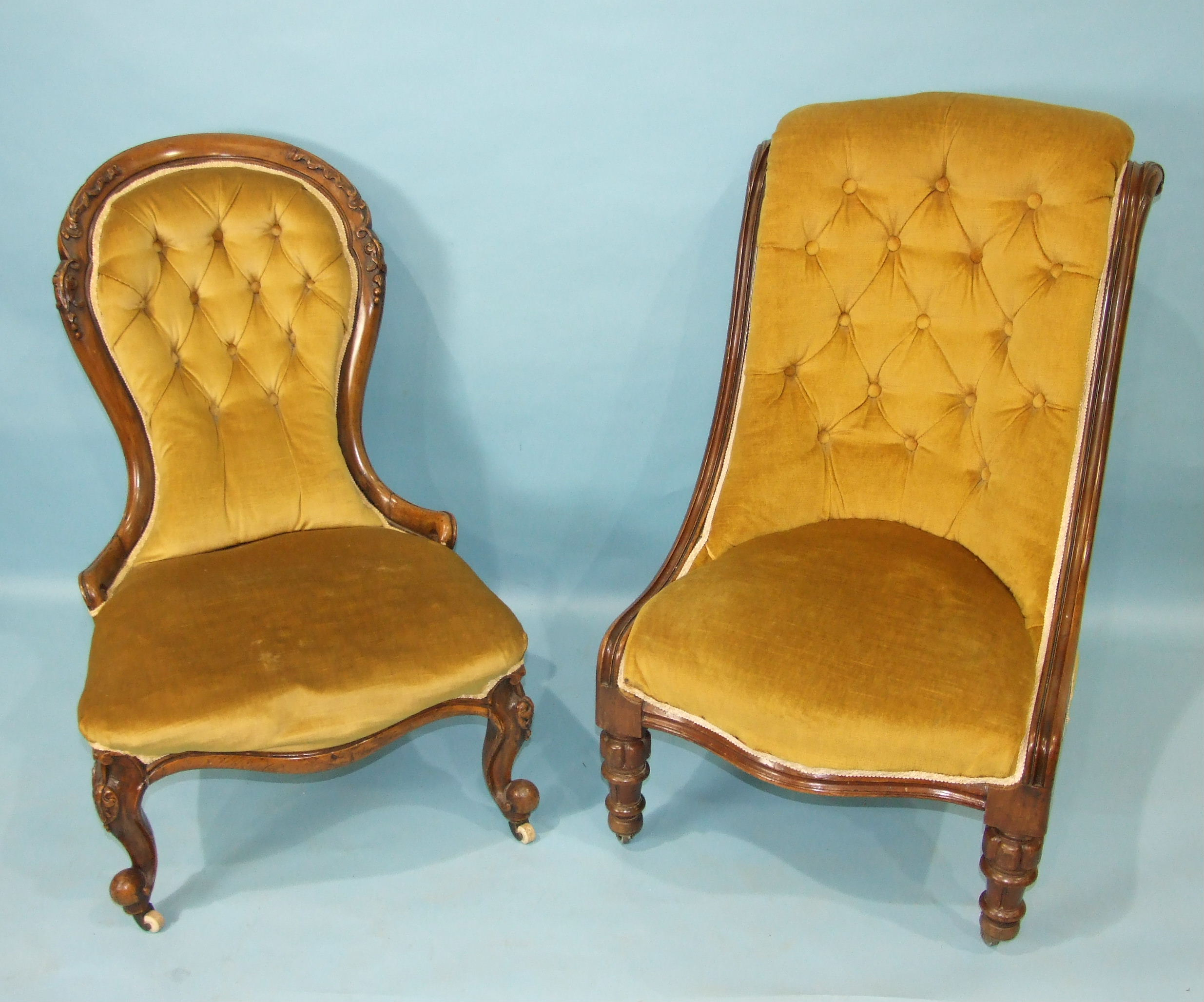 A Victorian mahogany low salon chair with buttoned back and serpentine seat, on carved and turned