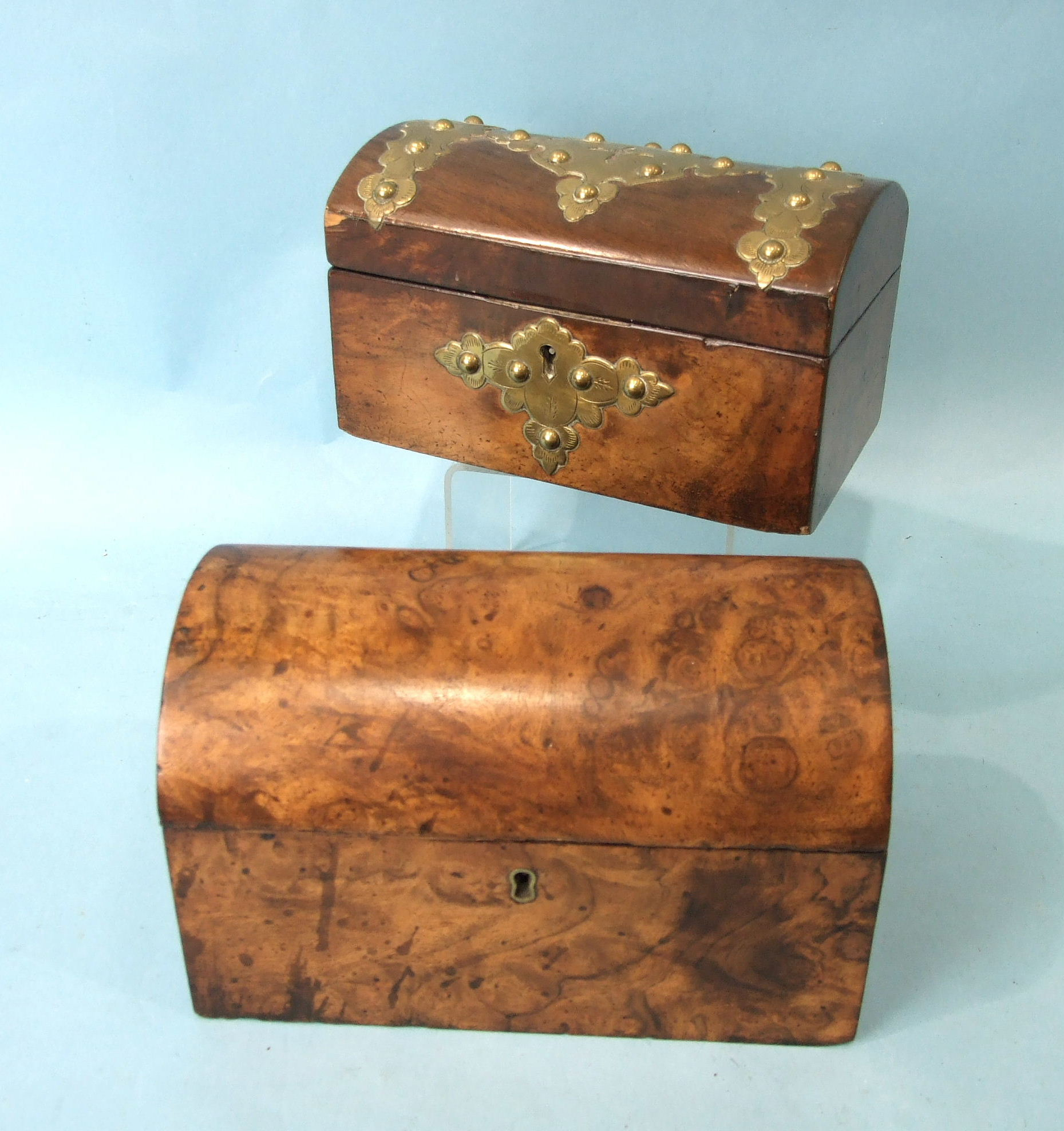 A Victorian burr walnut two-division tea caddy with domed lid, 21cm wide and a brass-bound walnut