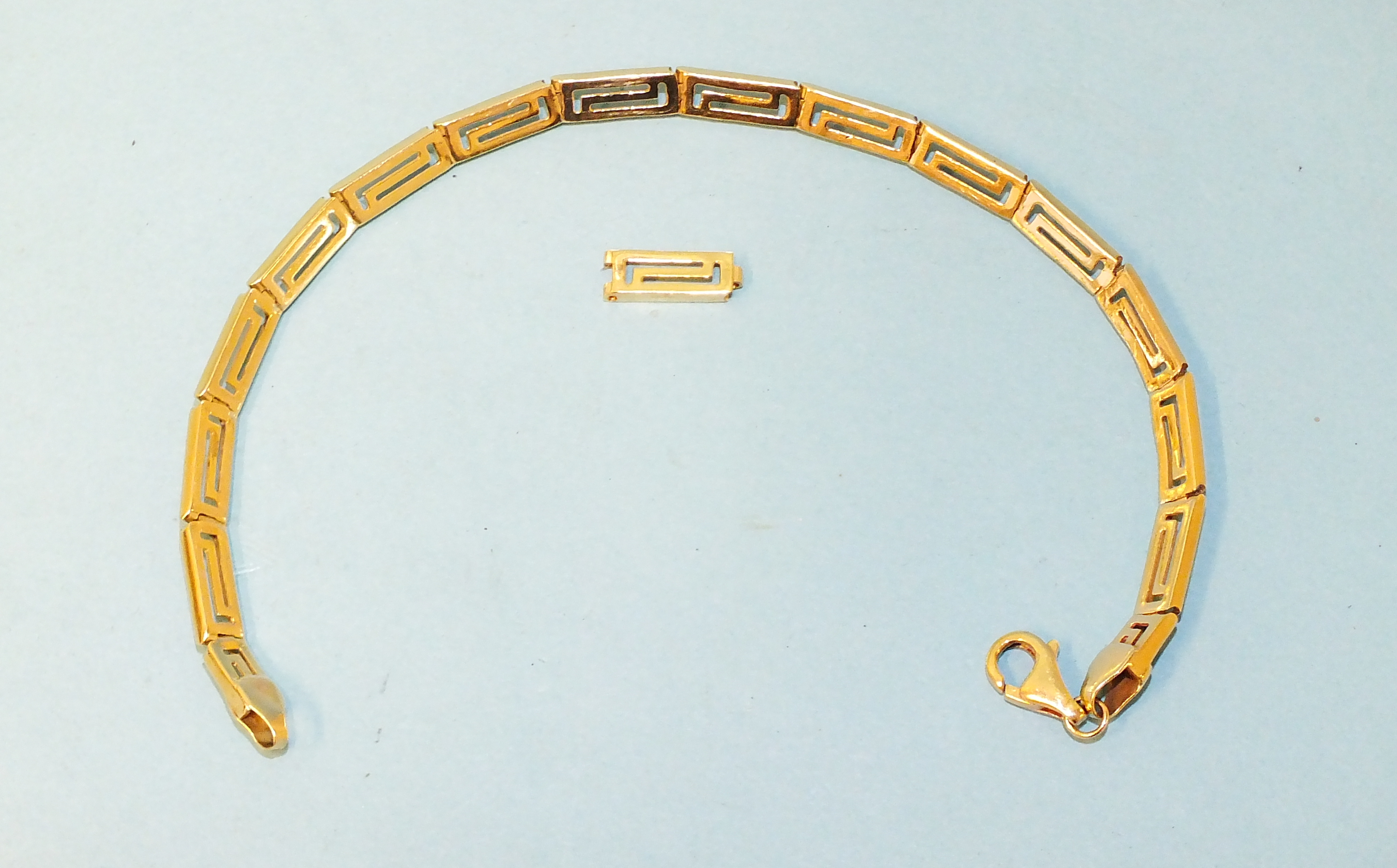 A 14ct yellow gold bracelet of geometric links, 19cm and an extra link, 8.4g.