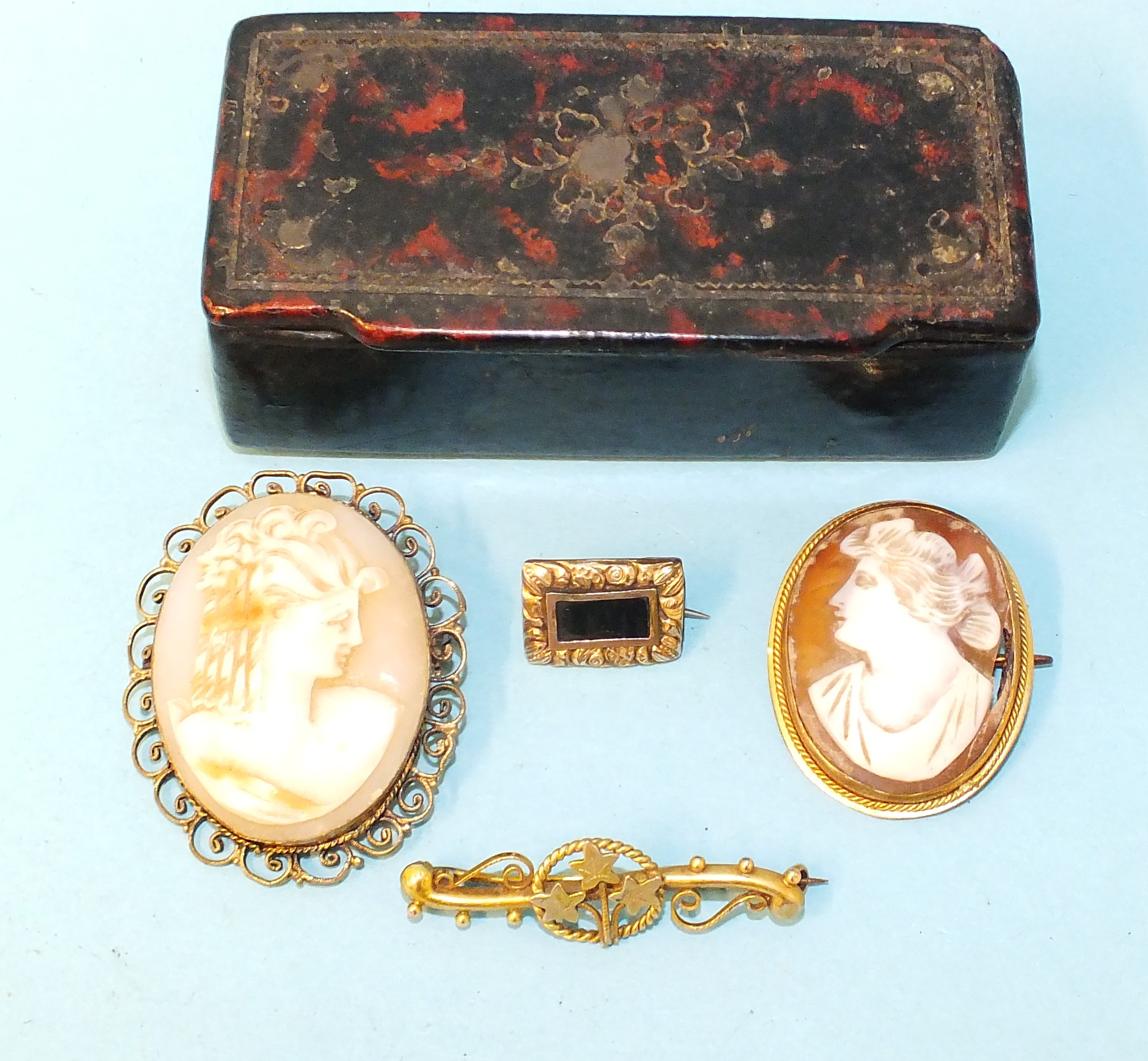 A small 19th century mourning brooch, a 9ct gold bar brooch with ivy leaf decoration and two shell