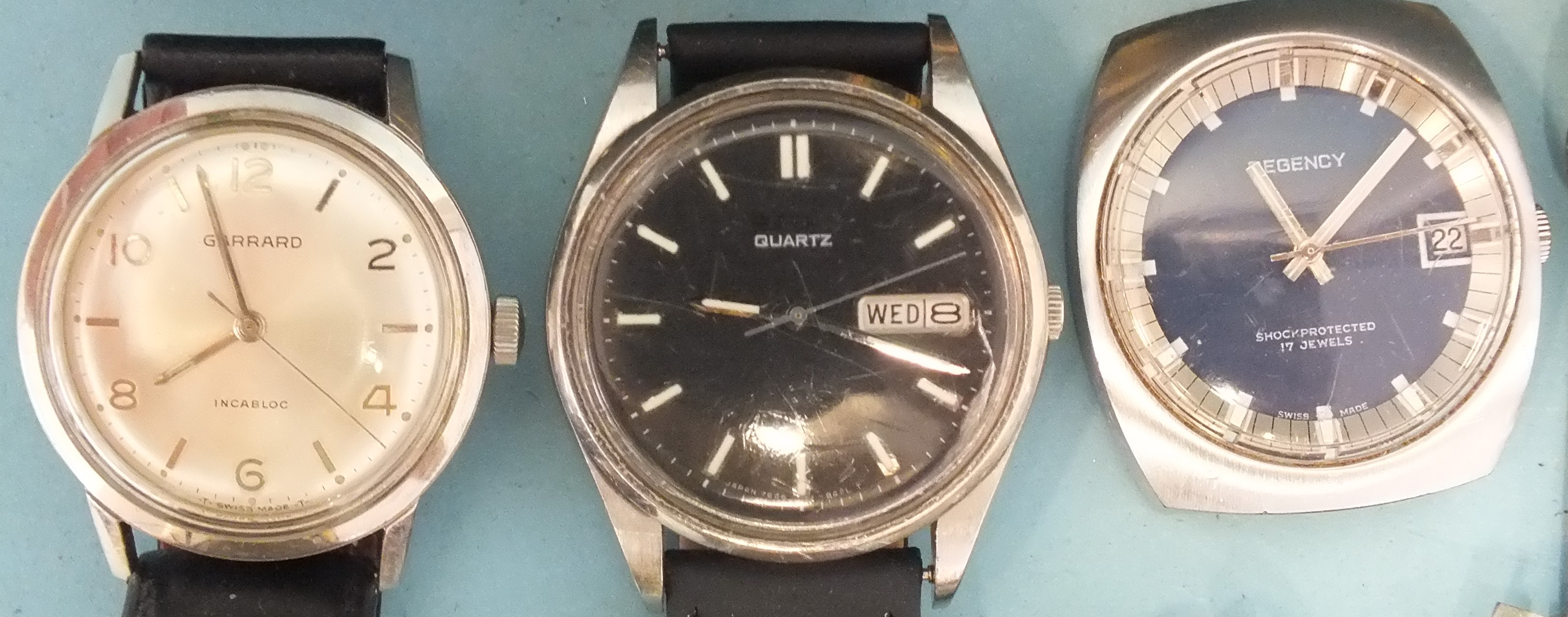 Garrard, a gentleman's Garrard Incabloc steel-cased wrist watch and other watches, in an Omega - Image 2 of 2