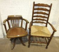 An oak revolving office armchair with padded seat and a set of six stained wood ladder-back dining