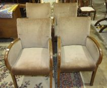A set of four 1950's stained wood frame low chairs with upholstered seat and back, (4).