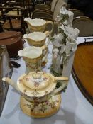 A graduated set of three Crown Devon 'Etria' decorated jugs, a similarly-decorated teapot and oval