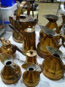 A set of five unmarked copper graduated measuring jugs, tallest 26cm, smallest 13cm, a copper