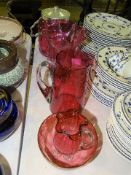 A cranberry glass biscuit barrel with plated mount, lid and handle, 27cm high overall, a cranberry