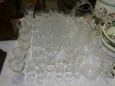 A cut-glass basket shape bowl and jug, and a collection of drinking glasses, including Champagne