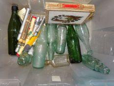 Four glass Codd bottles, including The Yacht Beverage Co. Ltd, Exeter, a Schweppes torpedo bottle,