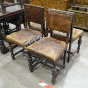 A set of seven 20th century Jacobean-style chairs, (studded leather upholstery damaged), including
