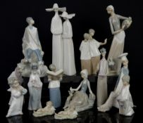 Quantity of Lladro and Nao figurines including nuns, choir boys, priest with book, three wise men