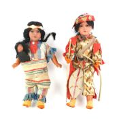 WITHDRAWN Two Native American Armand Marseille dolls, one carrying two bows, marked 14/0, 33cm high,