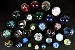 Various glass paperweights, comprising Caithness, Isle of Wight and others (35+)