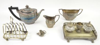 Small group of silver plate to include a three piece tea service, toast rack and desk set, bottle