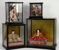 Traditional Japanese doll seated on a tatami mat, within a glass case w42cm x h43.5cm, another