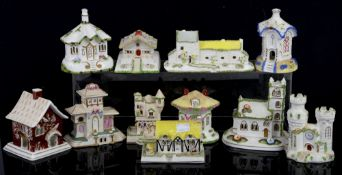 Coalport porcelain pastille burner houses, including 'Swiss Cottage', h7.5cm, 'Elizabethan Cottage',