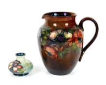 Moorcroft unusual brown flambe lustre glaze anemone jug, h20cm, and solifleur vase with orchid