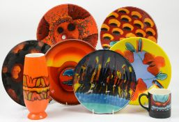 Five Poole Pottery dishes including an Alan Clarke planets dish 26.5cm diam, orange ground vase,