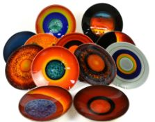 Poole Pottery 'Planets' set of dishes, designed by Alan Clarke, including Saturn marked 36,