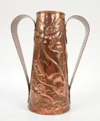 Newlyn school, Cornwall, beaten copper twin handled vase with stylised fish amongst seaweed in