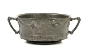 David Veasey for Liberty and co, Tudric pewter twin-handled bowl cast with a band of stylised trees