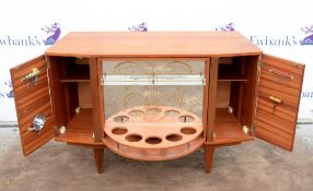 Mid century revolving cocktail cabinet with rotating central unit flanked by two cupboards with