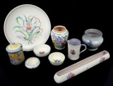 Nine pieces of Poole Pottery 1920's-50's and collectors club magazines, the plate diameter 25.