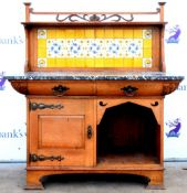 Art Nouveau oak washstand, the carved gallery with foliate decoration above a yellow tiled back,
